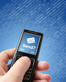 Send message?. Hand holding mobile phone. Sending new text message concept Royalty Free Stock Image