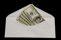 Send money. One hundred dollar bills in white envelope, isolated against black background (clipping path Royalty Free Stock Images