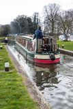 SEND, SURREY/UK - MARCH 25 : Narrow Boat on the River Wey Naviga. Tions Canal near Send in Surrey on March 25, 2015. Unidentified man Stock Photography