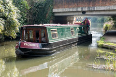 SEND, SURREY/UK - MARCH 25 : Narrow Boat on the River Wey Naviga. Tions Canal near Send in Surrey on March 25, 2015. Unidentified man Stock Photos