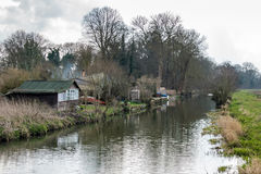 SEND, SURREY/UK - MARCH 25 : Old Wooden Shack near Papercourt Lo. Ck on the River Wey Navigations Canal near Send in Surrey on March 25, 2015 Royalty Free Stock Photos
