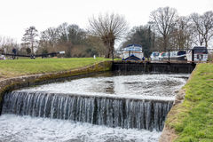 SEND, SURREY/UK - MARCH 25 : Papercourt Lock on the River Wey Na. Vigations Canal near Send in Surrey on March 25, 2015. unidentified man Stock Photo