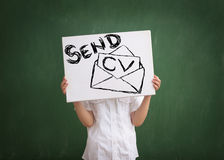 Send us your resume. Boy holding table with send cv text Stock Photography