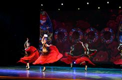 Send you a rose 2 -Chinese national dance in Xinjiang. It is a dance widely distributed in the Uygur ethnic group, accompanied by the music of the king of the Stock Image