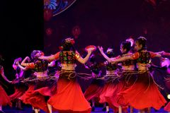 Send you a rose 3 -Chinese national dance in Xinjiang. It is a dance widely distributed in the Uygur ethnic group, accompanied by the music of the king of the Royalty Free Stock Image