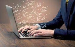 Sending client news letters on laptop Stock Images