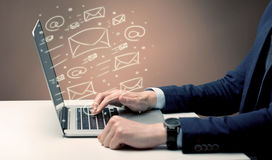 Sending client news letters on laptop Royalty Free Stock Image