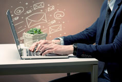 Sending client news letters on laptop Royalty Free Stock Images