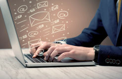 Sending client news letters on laptop Royalty Free Stock Photo