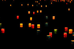 Sending down paper lanterns in the the pond of Arashiyama, Kyoto Japan. On the last day of Japanese Obon ceremony, people floated down paper lanterns in the Stock Images