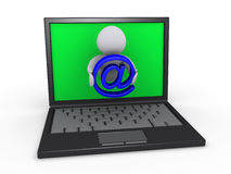 Sending e-mail through laptop Royalty Free Stock Images