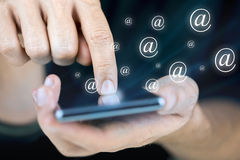 Sending email on mobile phone Royalty Free Stock Photos