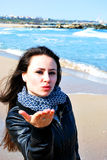 Sending a kiss from the sea stock photography