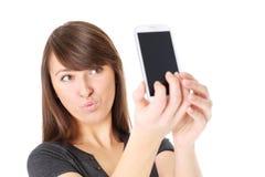 Sending kisses via cellphone Stock Photo