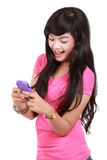 Sending message. Happy teenager texting a message royalty free stock image