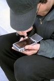 Sending a message. Using handheld device Stock Photo