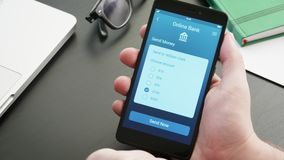 Sending money using banking app on the smatphone. Stock footage stock footage