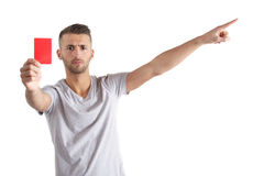 Sending-Off. A handsome man shows someone a red card. All isolated on white background Royalty Free Stock Photography