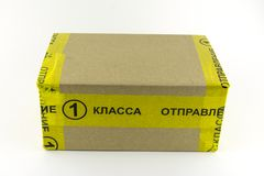 Sending Russian Mail. Administration of the First class. A box wrapped in yellow tape.  royalty free stock image