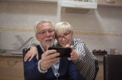 Sending selfie to our grandchild stock photography