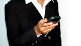 Sending SMS. Corporate women sending SMS stock images