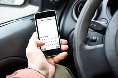 Sending sms while driving Royalty Free Stock Image