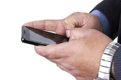 Sending sms on his mobile phone Stock Photo