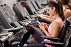 Sending a text during gym class Stock Photo