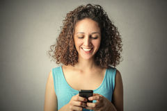 Sending a text message Royalty Free Stock Photos