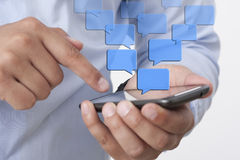 Sending Text Messaging via Smart Phone. Sending Text Messaging via Mobile Phone Stock Photos