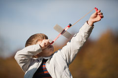 Sending up an airplane. Boy is sending up a model of airplane. The momant of launch Stock Images