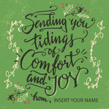 Sending you tidings of comfort and joy. Holiday greeting card calligraphy in vintage style Royalty Free Stock Photos