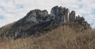 Seneca Rocks State Park in West Virginia. View of seneca rocks at the state park in West Virginia. Beautiful rock formation against blue and cloudy sky stock photography