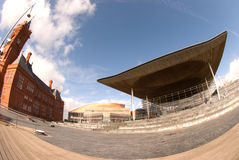 Senedd, Cardiff Bay. Fish-eye view of the Senedd and Pierhead Building with Wales Millenium Centre in background Royalty Free Stock Image