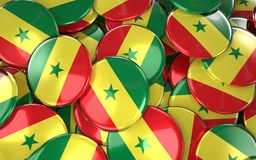 Senegal Badges Background - Pile of senegalese Flag Buttons. Stock Images