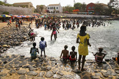 Senegal Children Play. In sea by rocky beach Stock Image