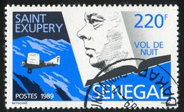 Antoine de Saint-Exupery. SENEGAL - CIRCA 1989: stamp printed by Senegal, shows Antoine de Saint-Exupery, Night flier, circa 1989 Stock Photography