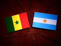 Senegal flag with Argentinian flag on a tree stump isolated Stock Photos