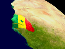 Senegal with flag on Earth Royalty Free Stock Photo