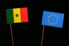 Senegal flag with European Union EU flag  on black Stock Image