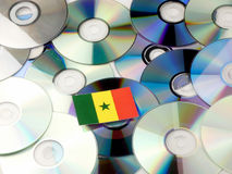 Senegal flag on top of CD and DVD pile isolated on white. Senegal flag on top of CD and DVD pile isolated Stock Photography