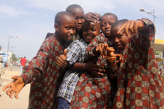 Senegalese Boys Celebrate Eid Holiday. Five happy Senegalese boys celebrate the Tabaski holiday (Muslim festival of Eid-al-Adha) and show off their festive Royalty Free Stock Image
