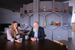Senescent man met with female employee for cup of tea during bre stock image