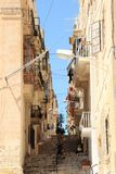 Senglea, Malta, July 2016. The old street of the city, the stairs between the houses. royalty free stock photos