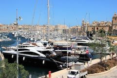 Senglea, Malta, July 2016. Parking with a huge number of yachts in the bay of a medieval city. Medieval fortifications in the background, numerous yachts and royalty free stock photography