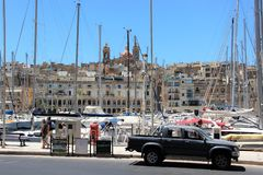 Senglea, Malta, July 2014. View of the parking of yachts in the bay of the old city. Sea bay between the cities on the island with the parking of numerous stock images
