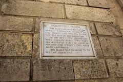 Senglea, Malta, July 2016. Wall of the Inquisition Palace with a memorial plaque. stock images