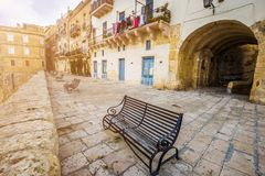 Senglea, Malta - Metal bench at the city of Senglea. On a sunny summer afternoon Stock Images
