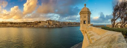 Senglea, Malta - Sunset and panoramic skyline view at the watch tower of Fort Saint Michael, Gardjola Gardens with beautiful sky Royalty Free Stock Images