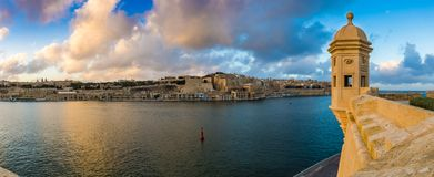Senglea, Malta - Sunset and panoramic skyline view at the watch tower of Fort Saint Michael, Gardjola Gardens with beautiful sky Stock Image